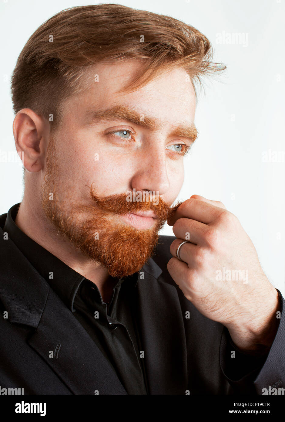 Young Red Hair Man With Beard And Mustache In Black Suit On White Stock Photo Alamy