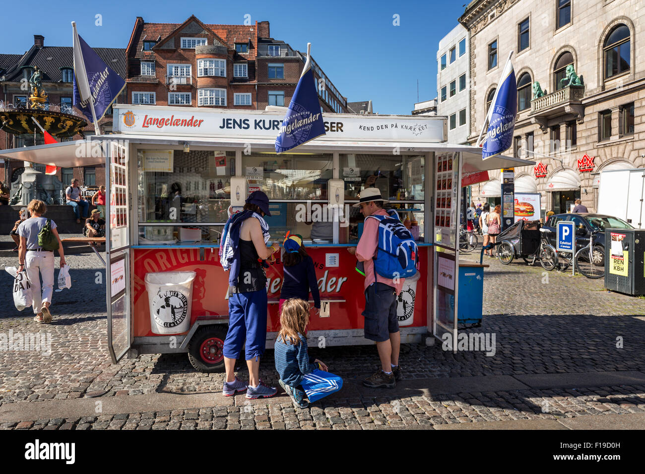 A typical and classic Danish pølsevogn (hot dog stand), on the main pedestrian street, Stroeget (Strøget) - Stock Image