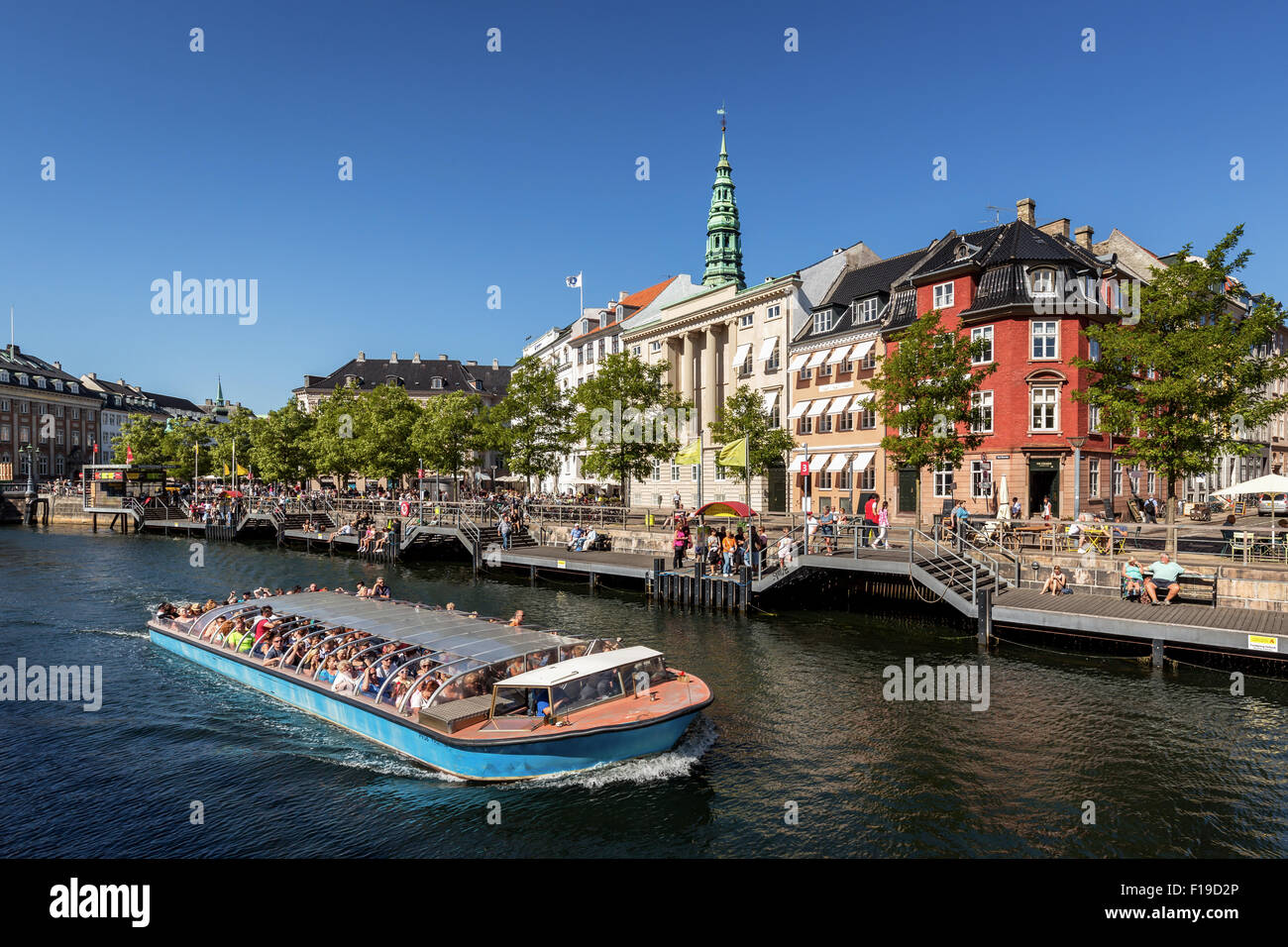 Tour boat with tourists in Copenhagen Canal, Copenhagen, Denmark - Stock Image