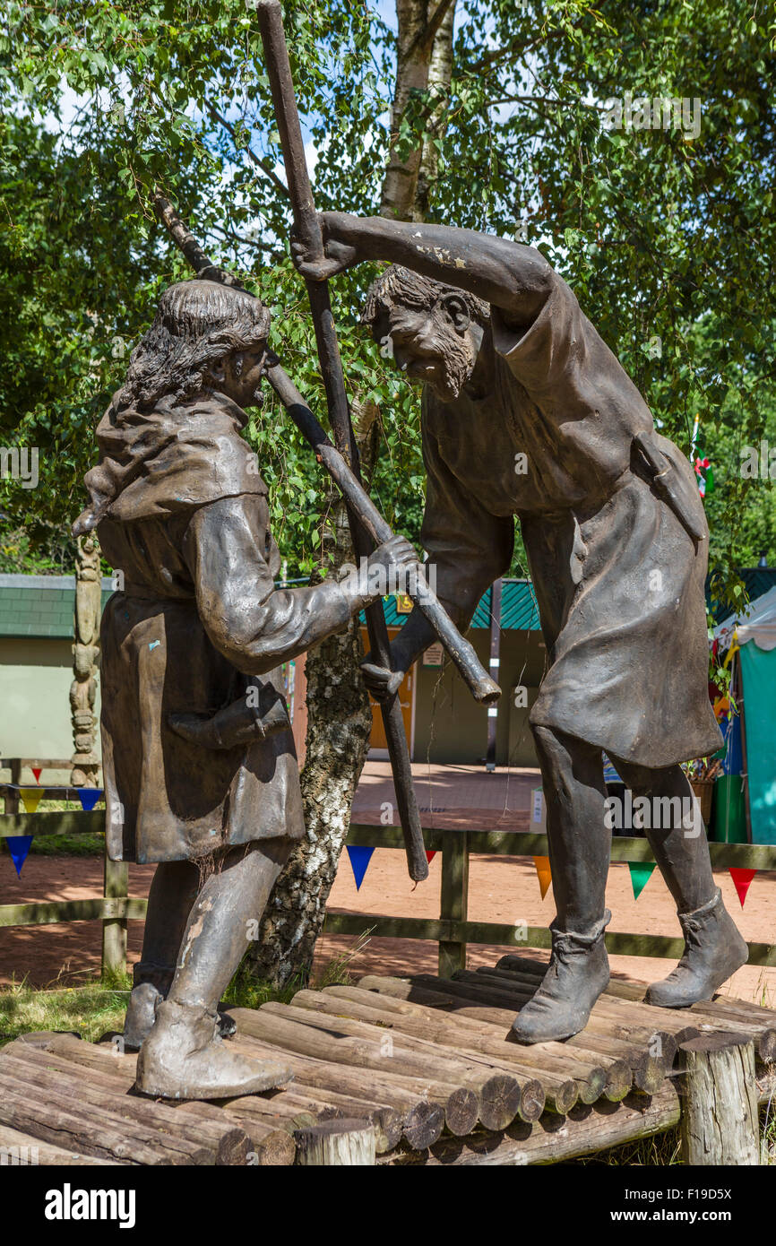 Statue of Robin Hood and Little John fighting on the bridge, Sherwood Forest Country Park, Edwinstowe, Notts, England, - Stock Image