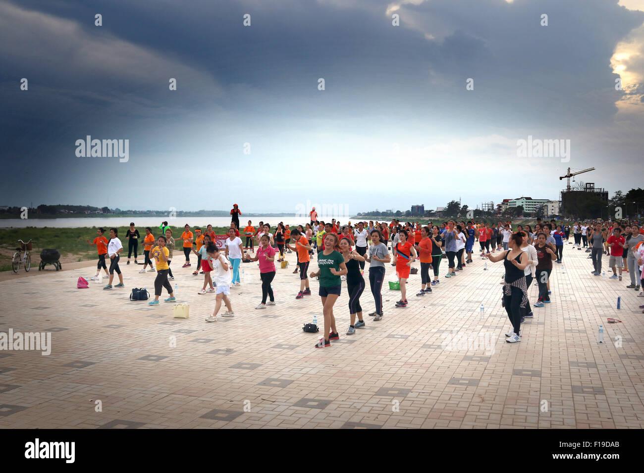 Aerobics exercise keep fit on banks of Mekong River - Stock Image