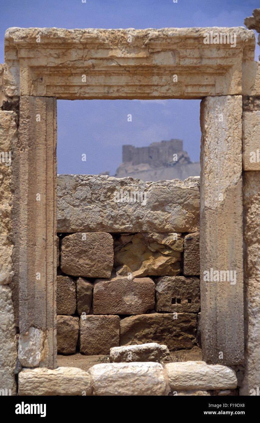 Stoned framed window looking the khr-al-Din al-Maani Castle in Palmyra - Stock Image