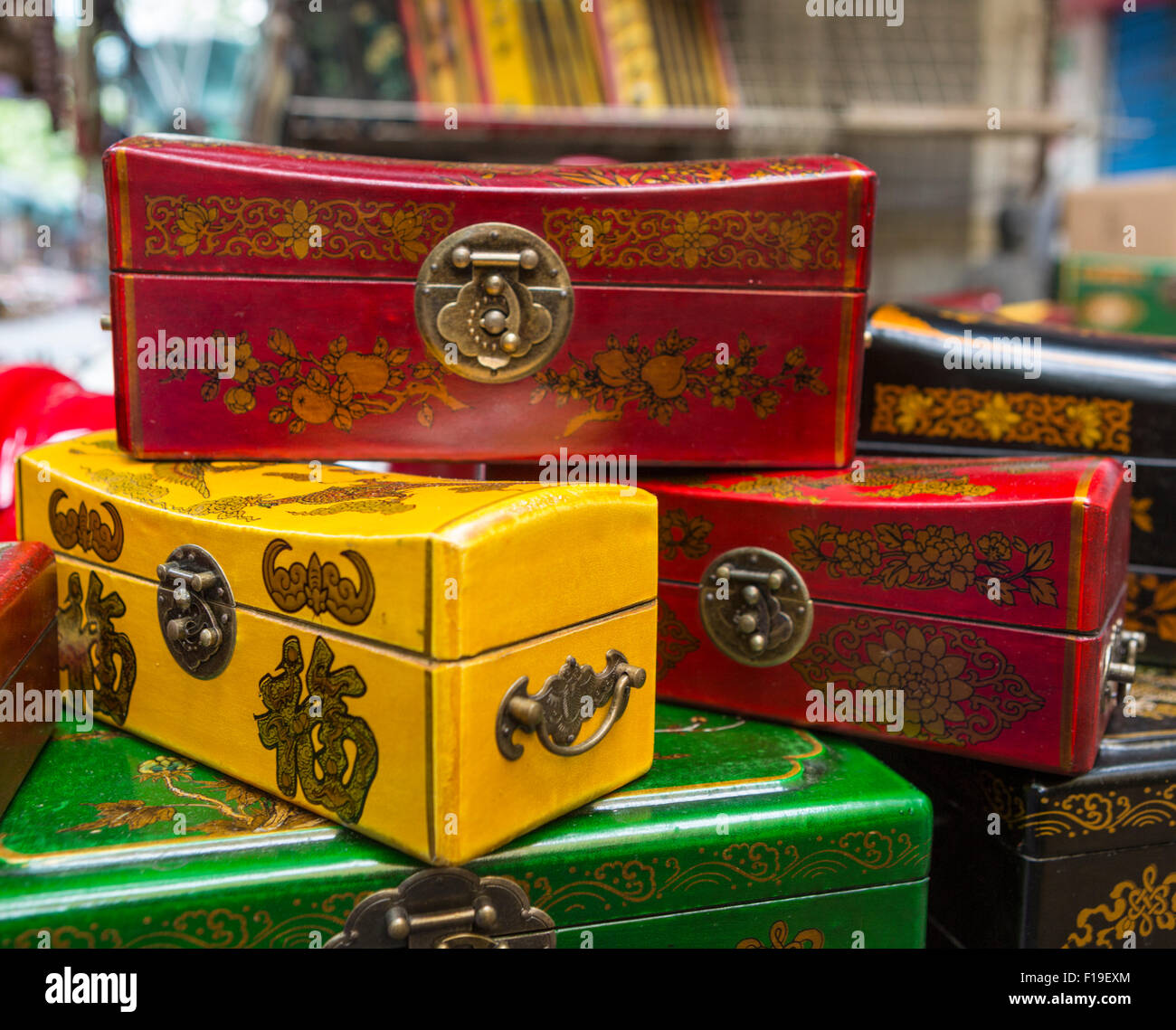 Colorful laquered boxes for sale on Chongde Rd in the Dongtai flea market in Shanghai, China - Stock Image