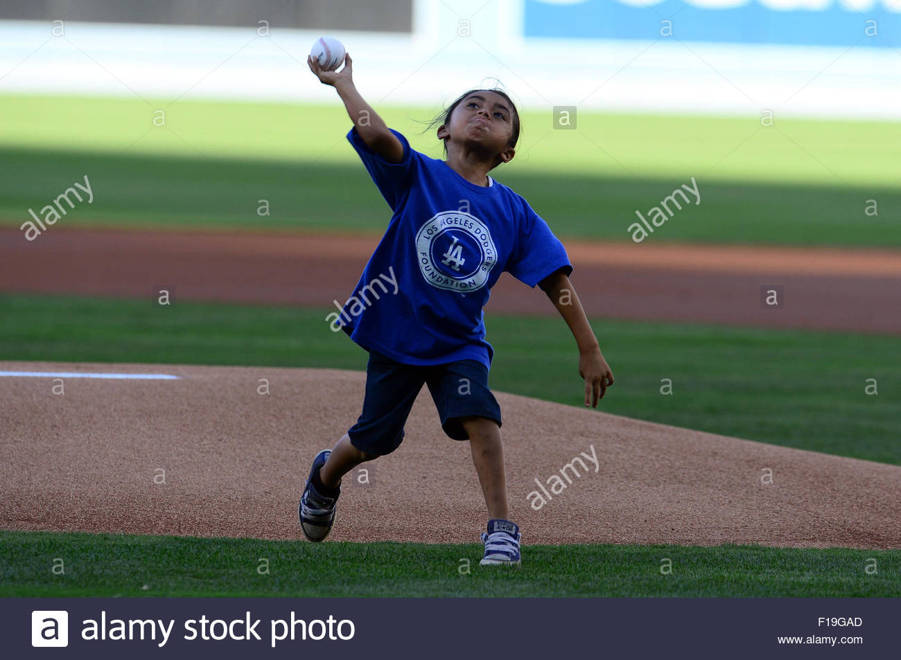 Los Angeles, California, USA. 30th Aug, 2015. Seven year-old Dainel Gutierrez of Los Angeles throws out the ceremonial Stock Photo