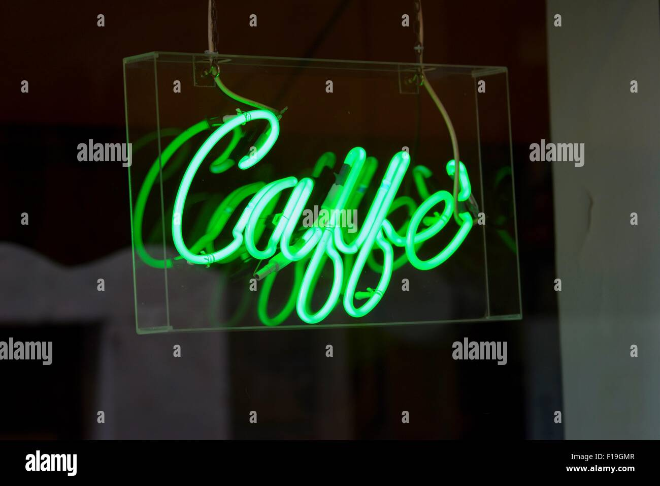 A neon Caffé (Italian for 'coffee') sign at a coffeehouse. - Stock Image
