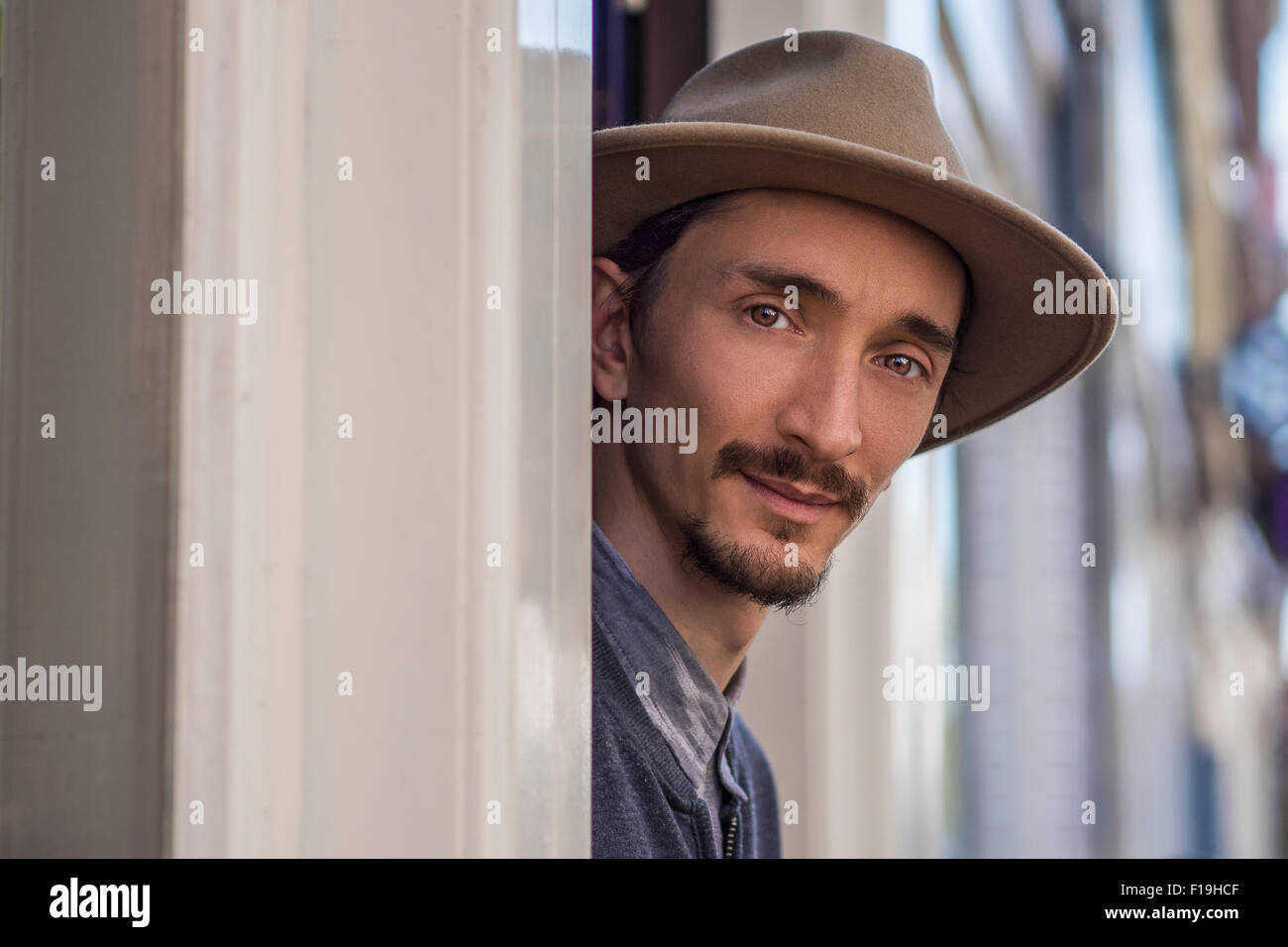 Portrait of a multi racial man outside of his store - Stock Image