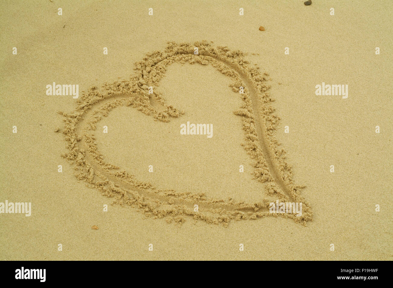A heart painted in the sand beach Stock Photo
