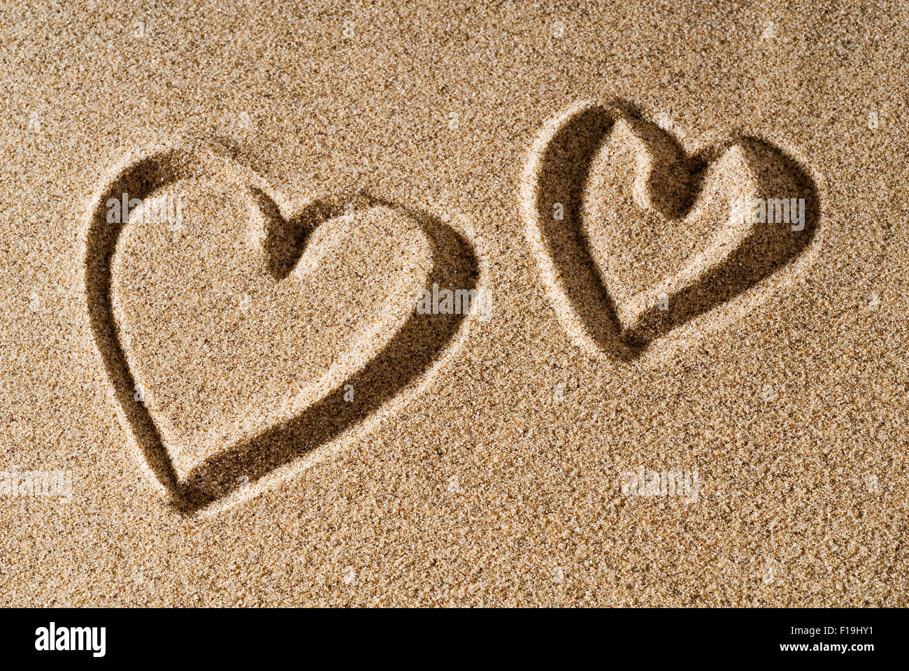 A heart painted in the sand - Stock Image