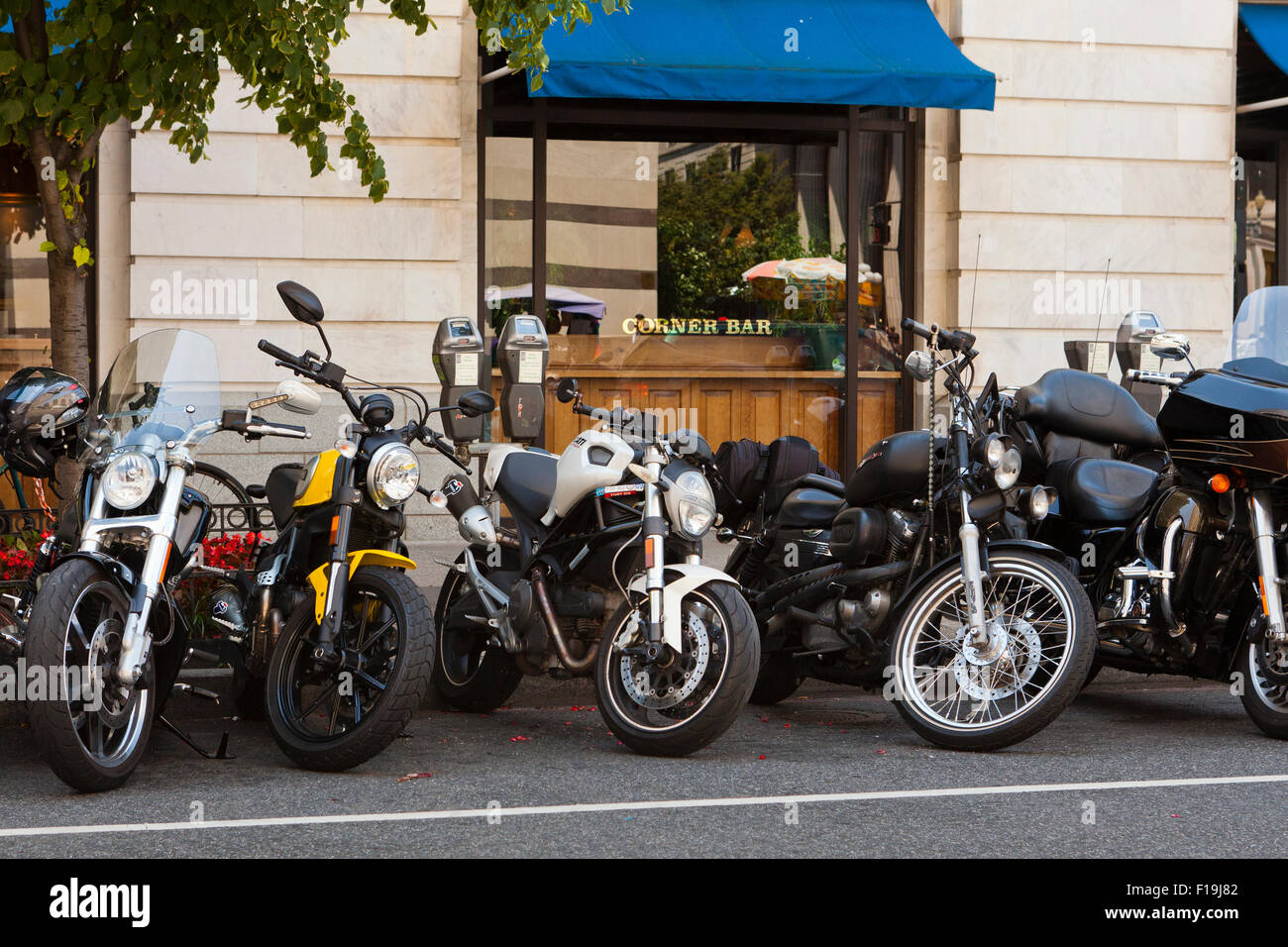 Motorcycles parked roadside - USA - Stock Image