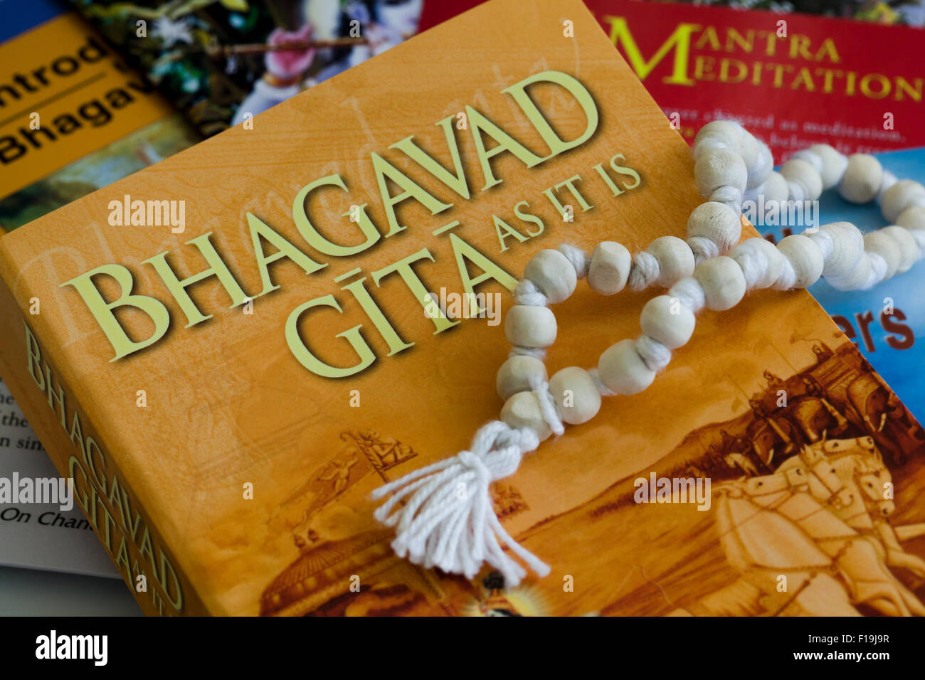 Krishna related books and meditation bead - Stock Image