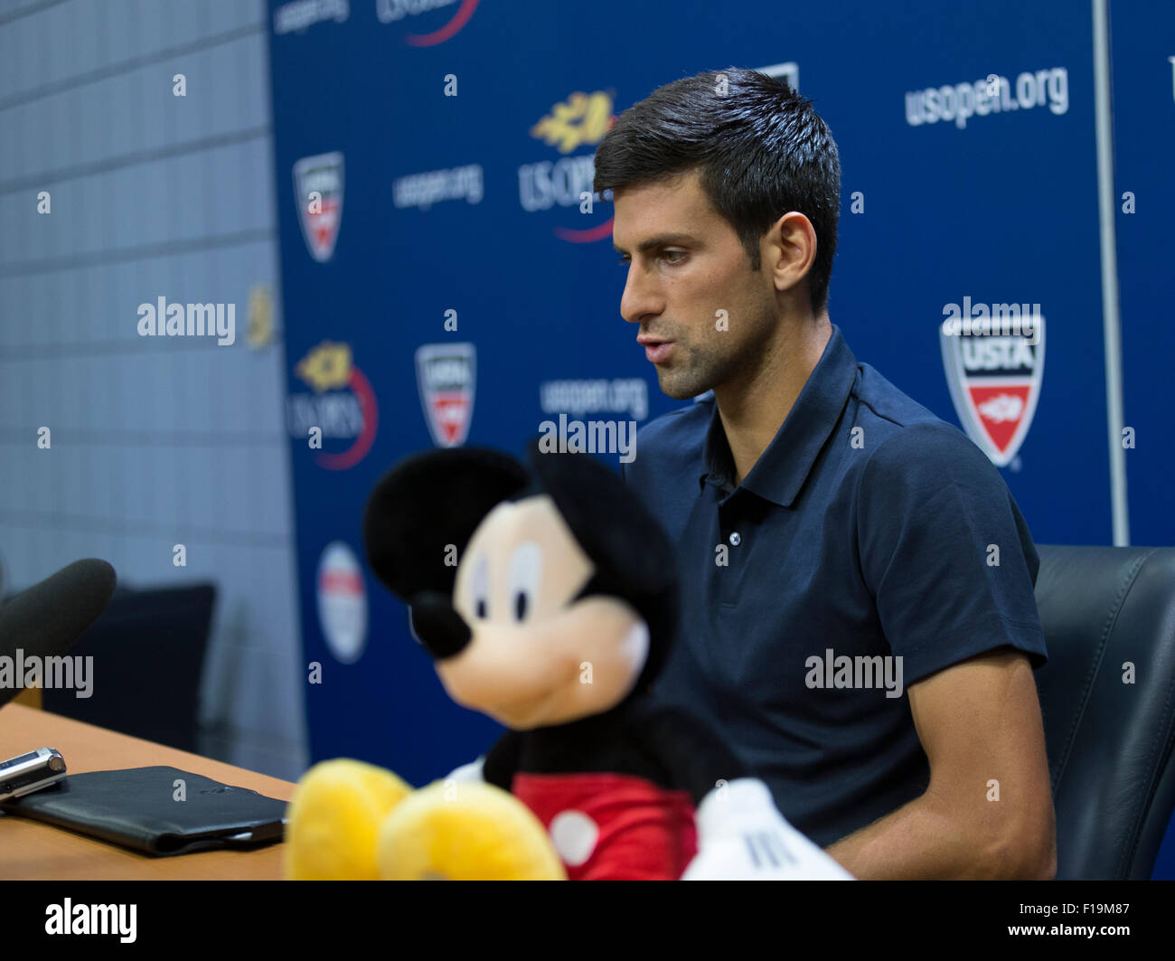 New York, NY - August 29, 2015: Novak Djokovic of Serbia and Mickey Mouse attend press conference at US Open Championship - Stock Image