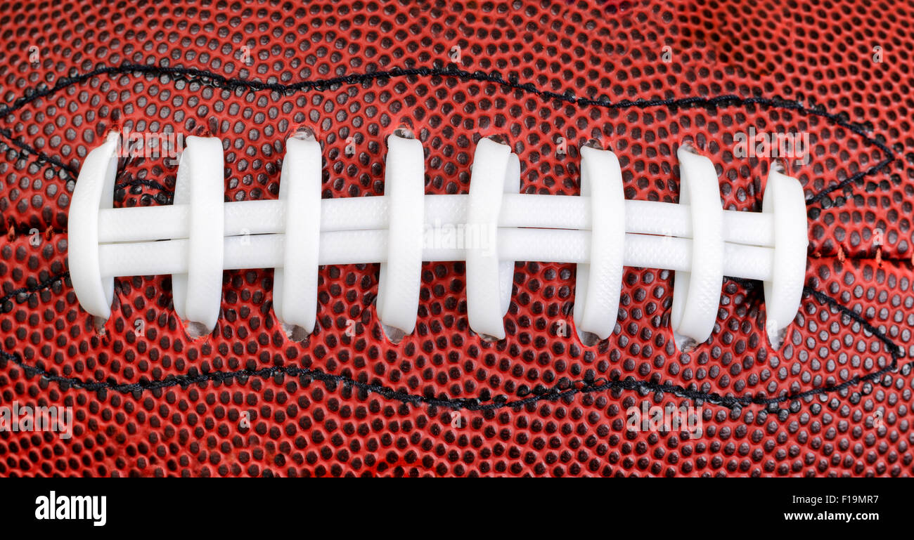 Close up of an American football in filled frame layout. - Stock Image