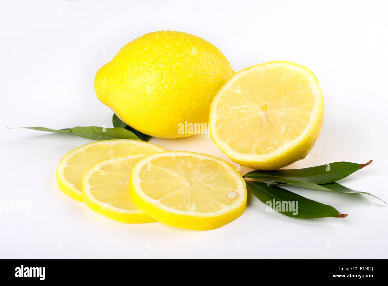 multiple lemon with fresh and delicious color isolated in white - Stock Image