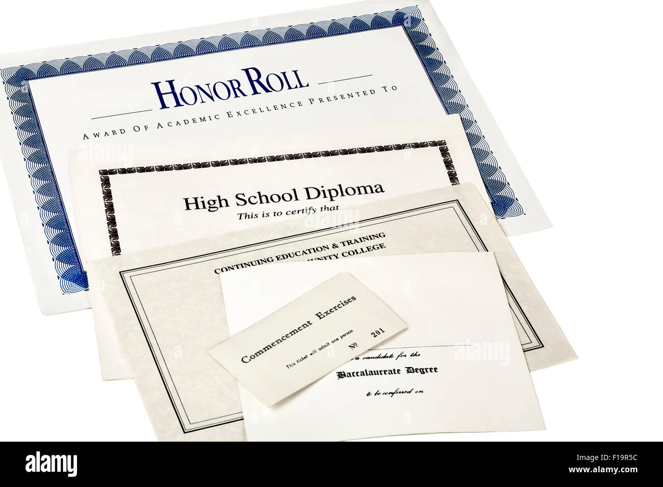 Education certification documents including high school diploma,commencement ticket, continuing education certificate - Stock Image