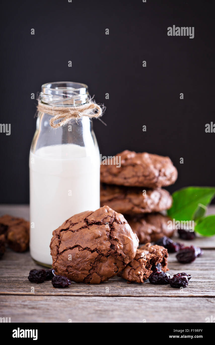 Chocolate cherry cookies and a bottle of milk - Stock Image