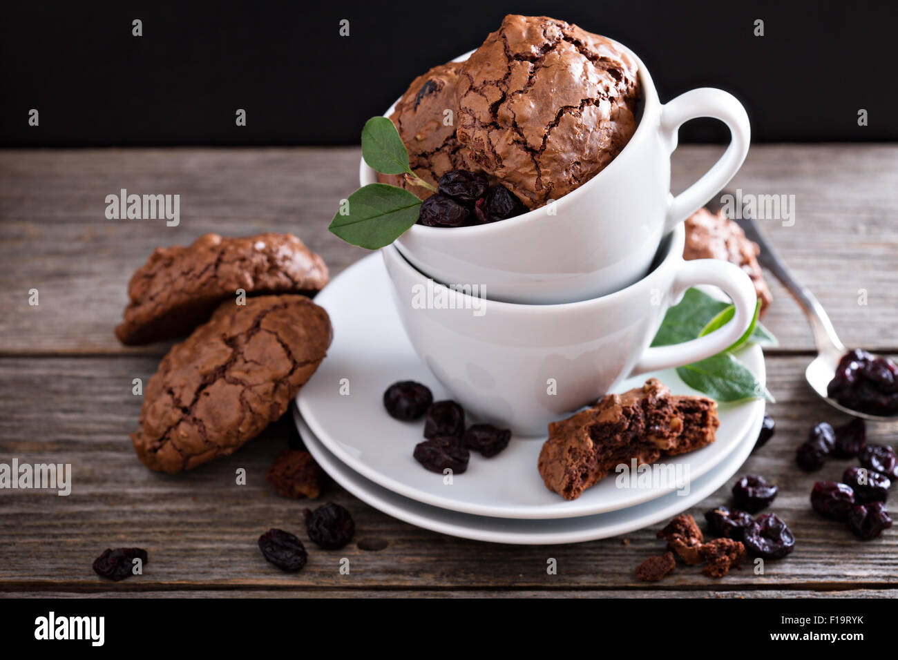 Chocolate walnut cherry cookies in coffee cups - Stock Image