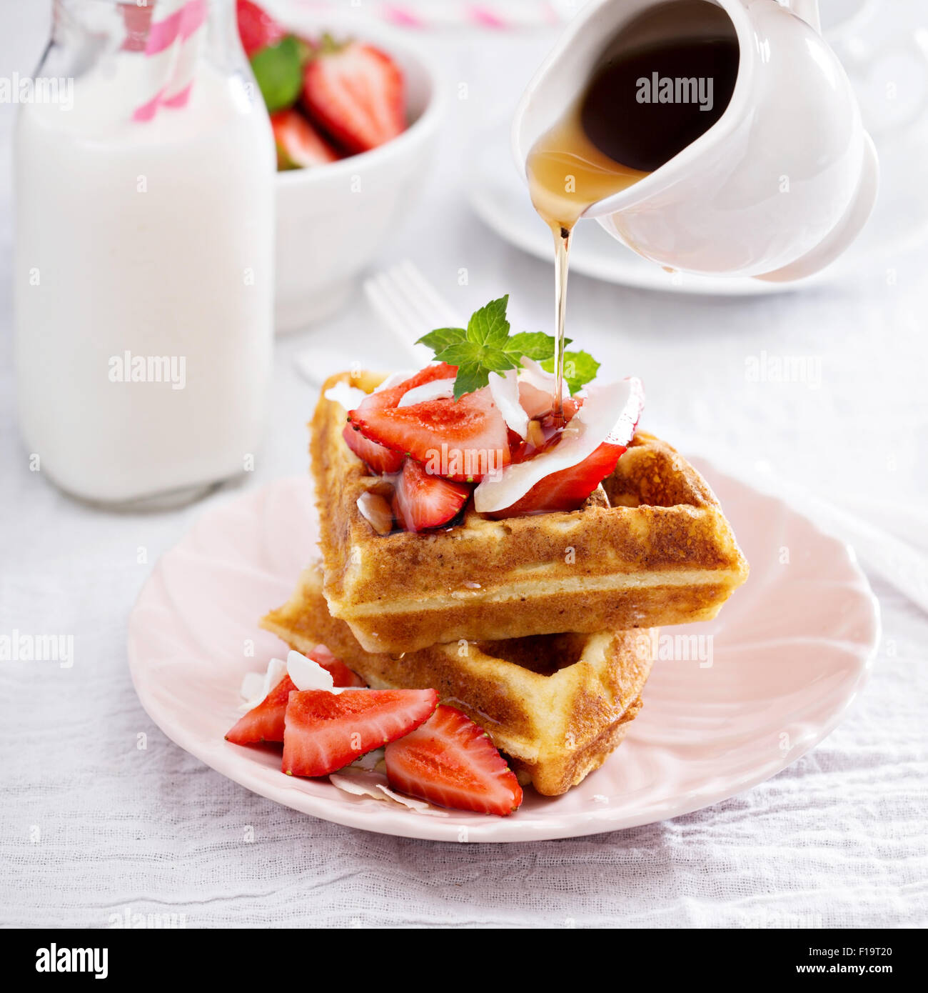 Ricotta waffles served with fresh strawberries and maple syrup - Stock Image