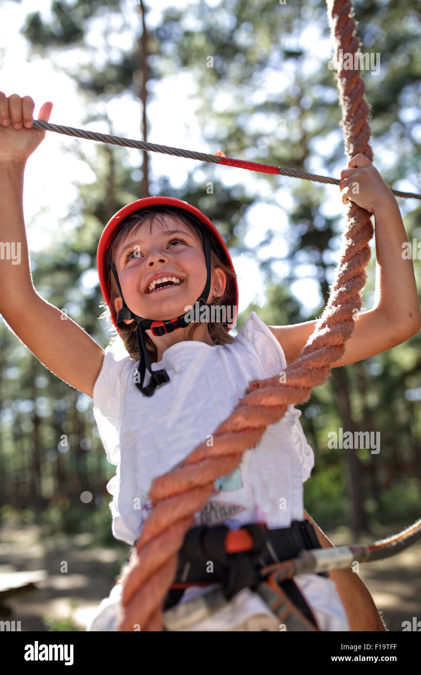 Young girl on the rope park - Stock Image