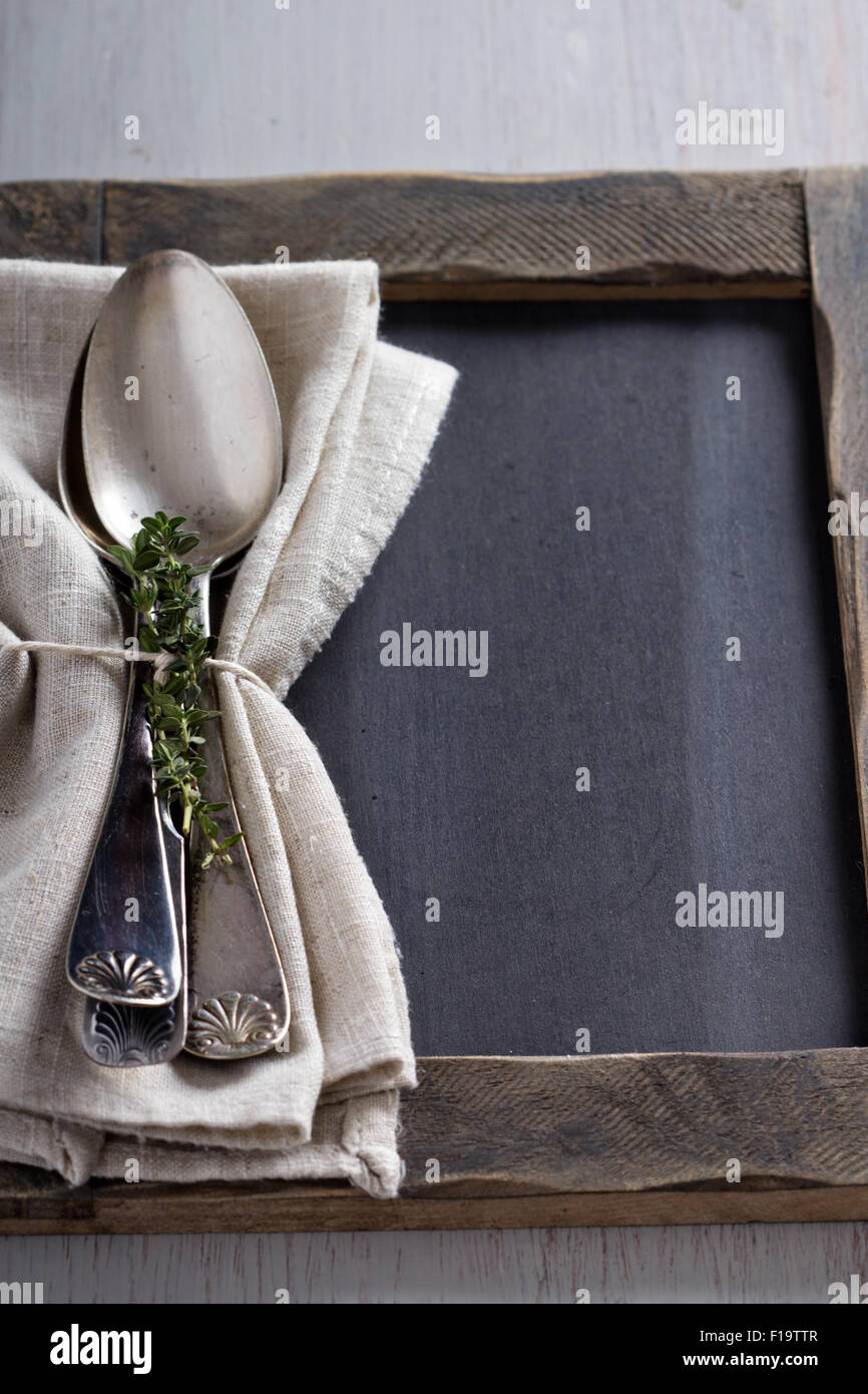 Tablespoons with a napkin and sprigs of thyme - Stock Image