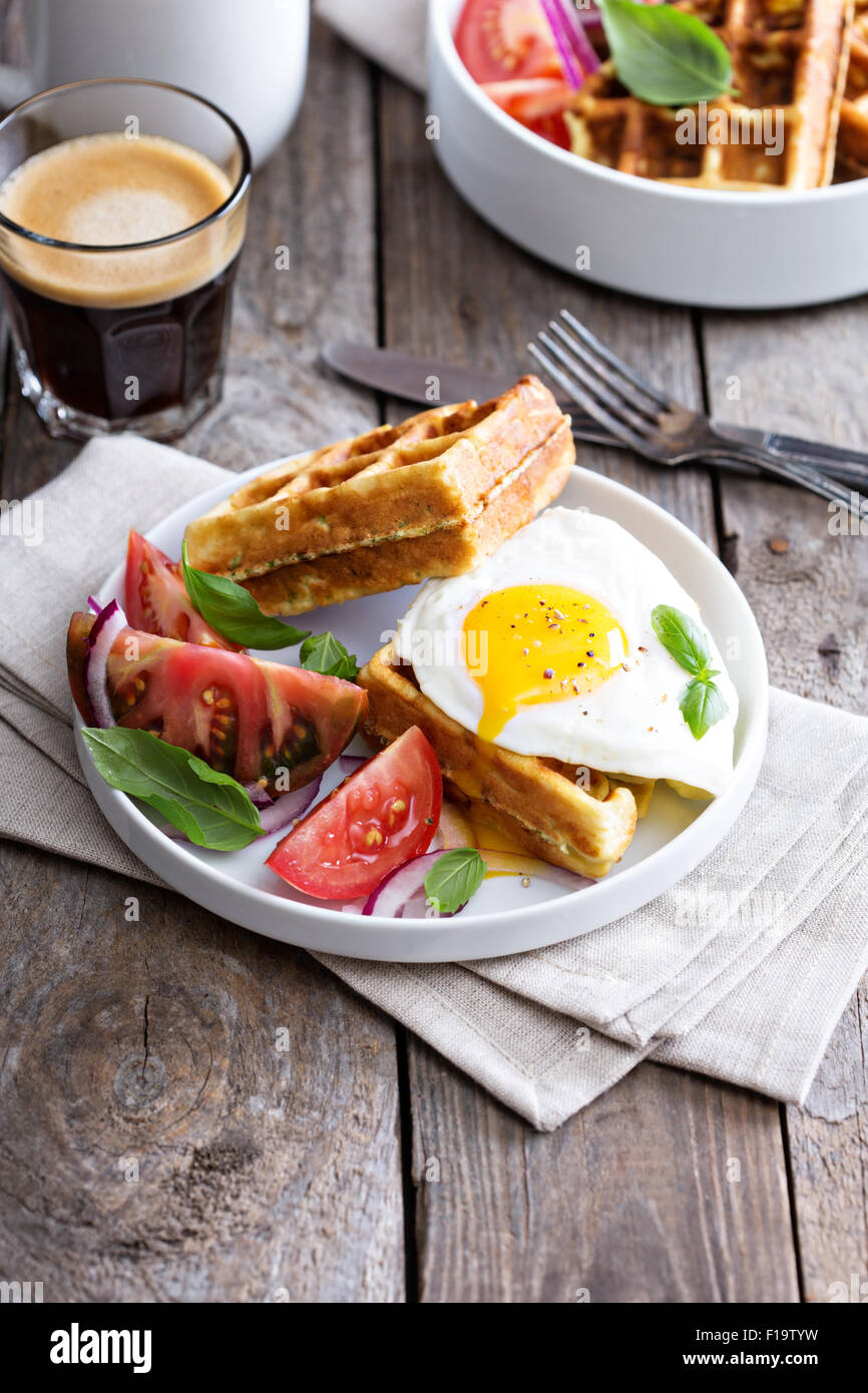 Chickpeas flour and zucchini waffles with tomatoes egg - Stock Image