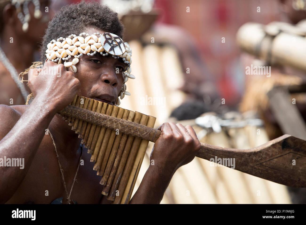 Honiara, Solomon Islands, local musician plays the pan flute. - Stock Image