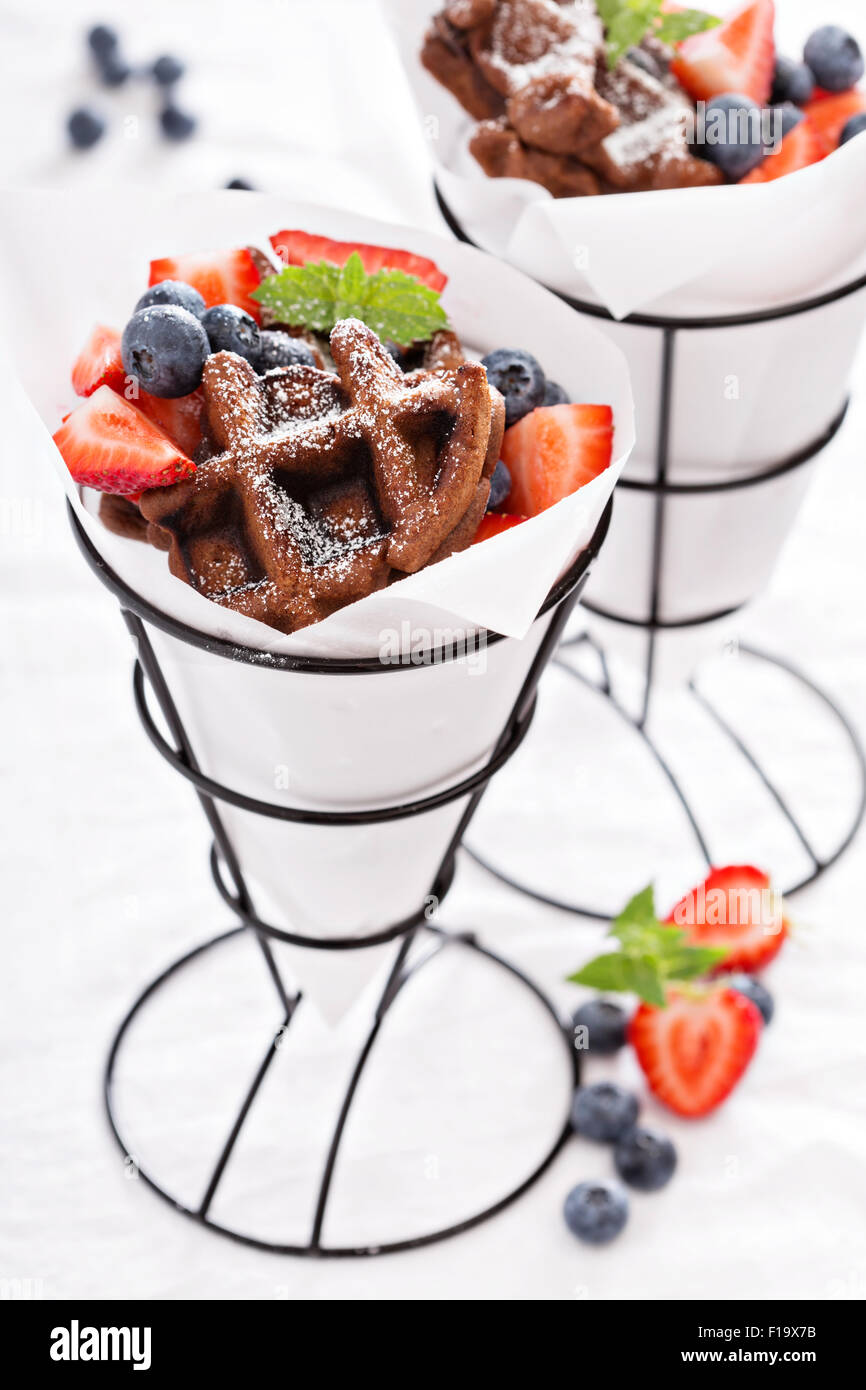 Small chocolate waffles with berries for dessert - Stock Image