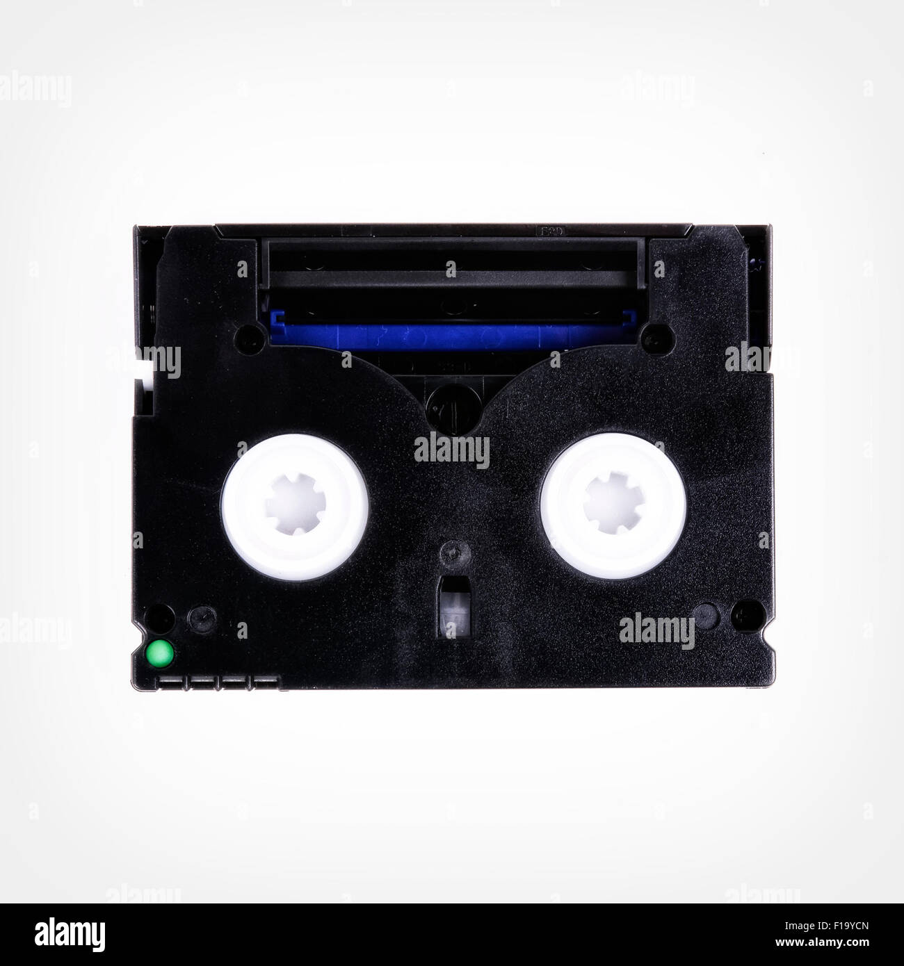 Cassette into the camera isolated on a white background - Stock Image