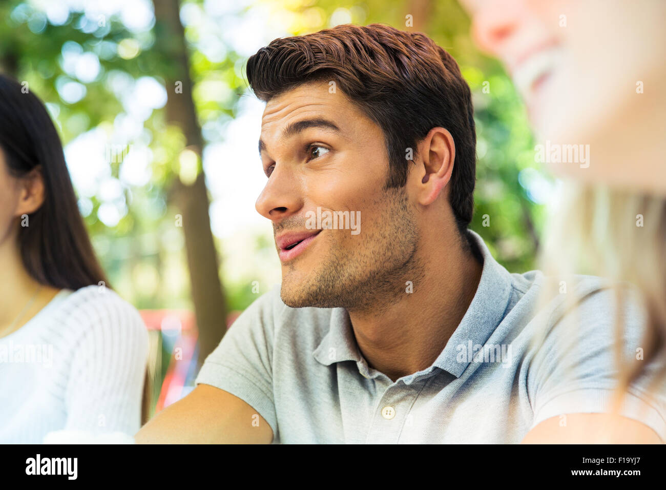 Portrait of a happy friends in outdoors restaurant - Stock Image