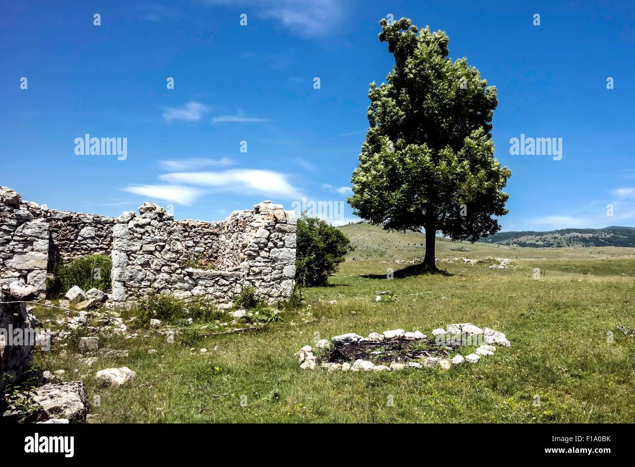 Destroyed house and a fireplace of shepards in mountain village Blace (Konjic). - Stock Image
