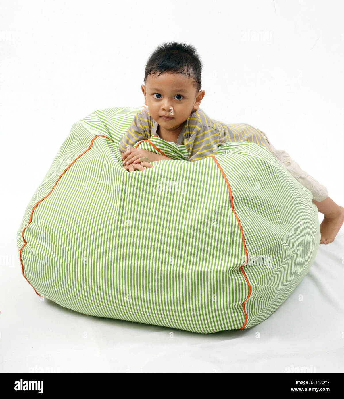 Kid play with bean bag chair Stock Photo