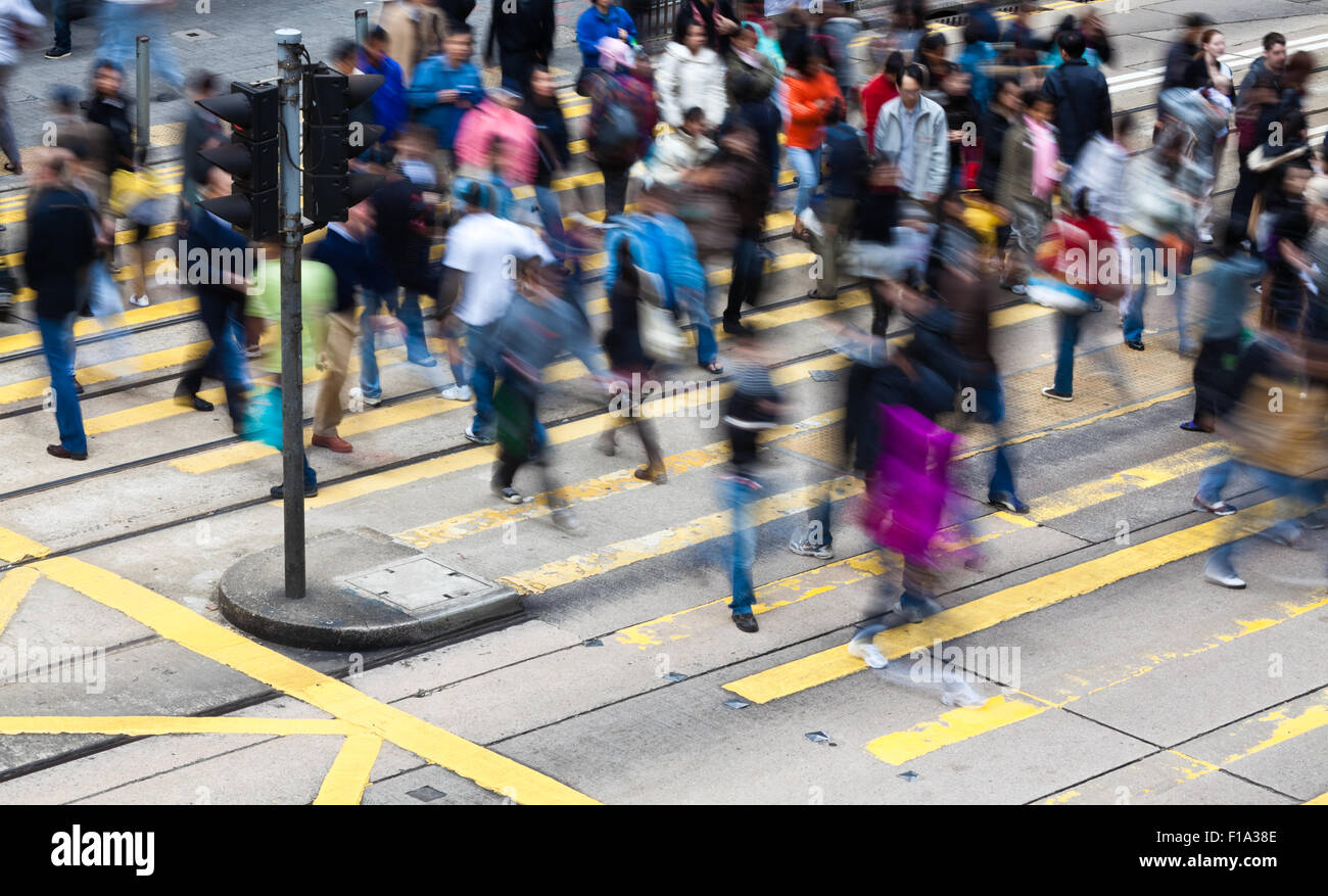 Commuters crossing a busy crosswalk - Stock Image