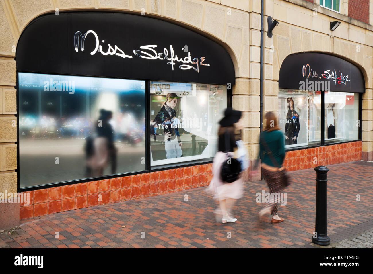 Sale promotion as Shoppers pass Miss Selfridge retail outlet in Preston, Lancashire, UK Stock Photo