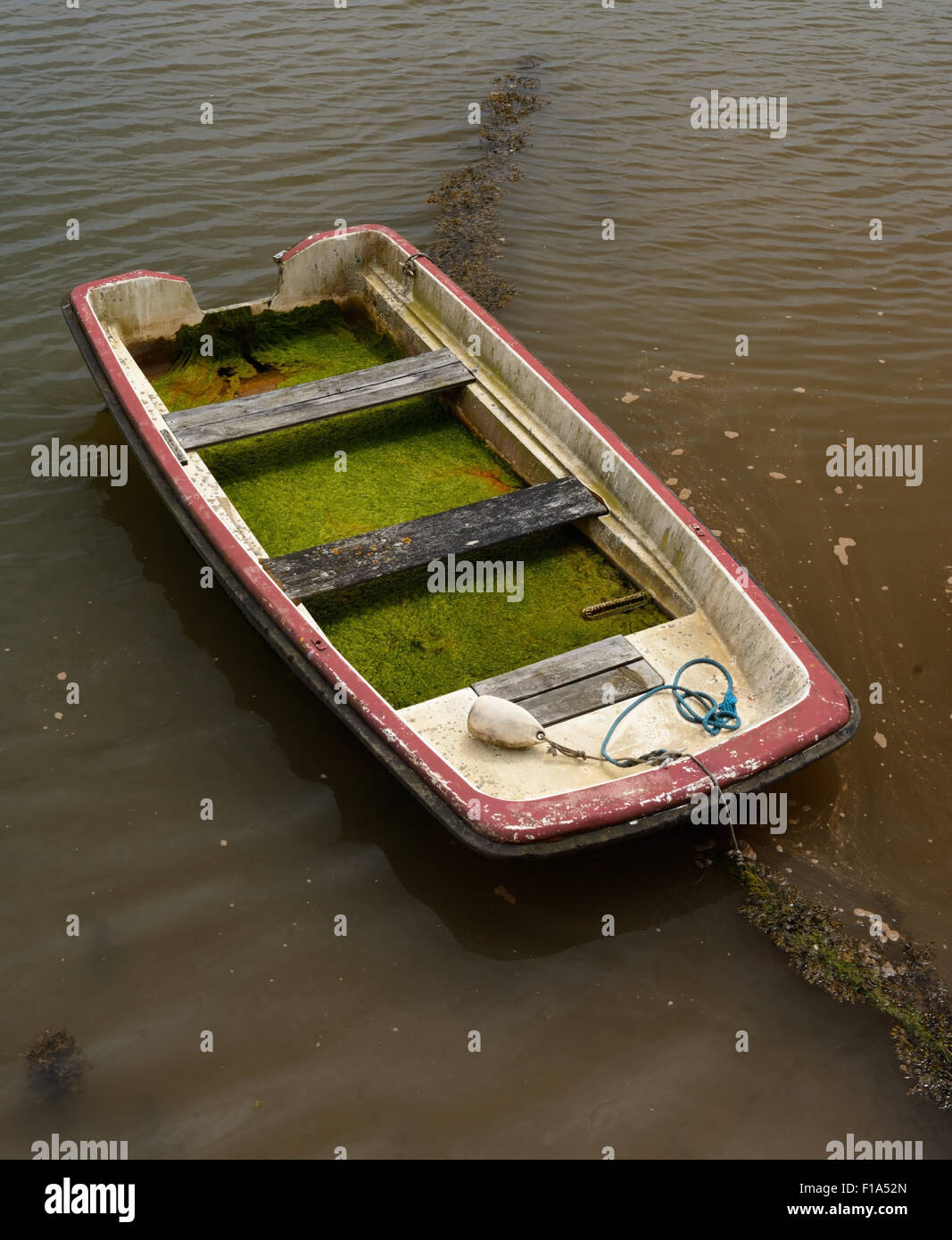 A dilapidated boat in need of some attention. - Stock Image