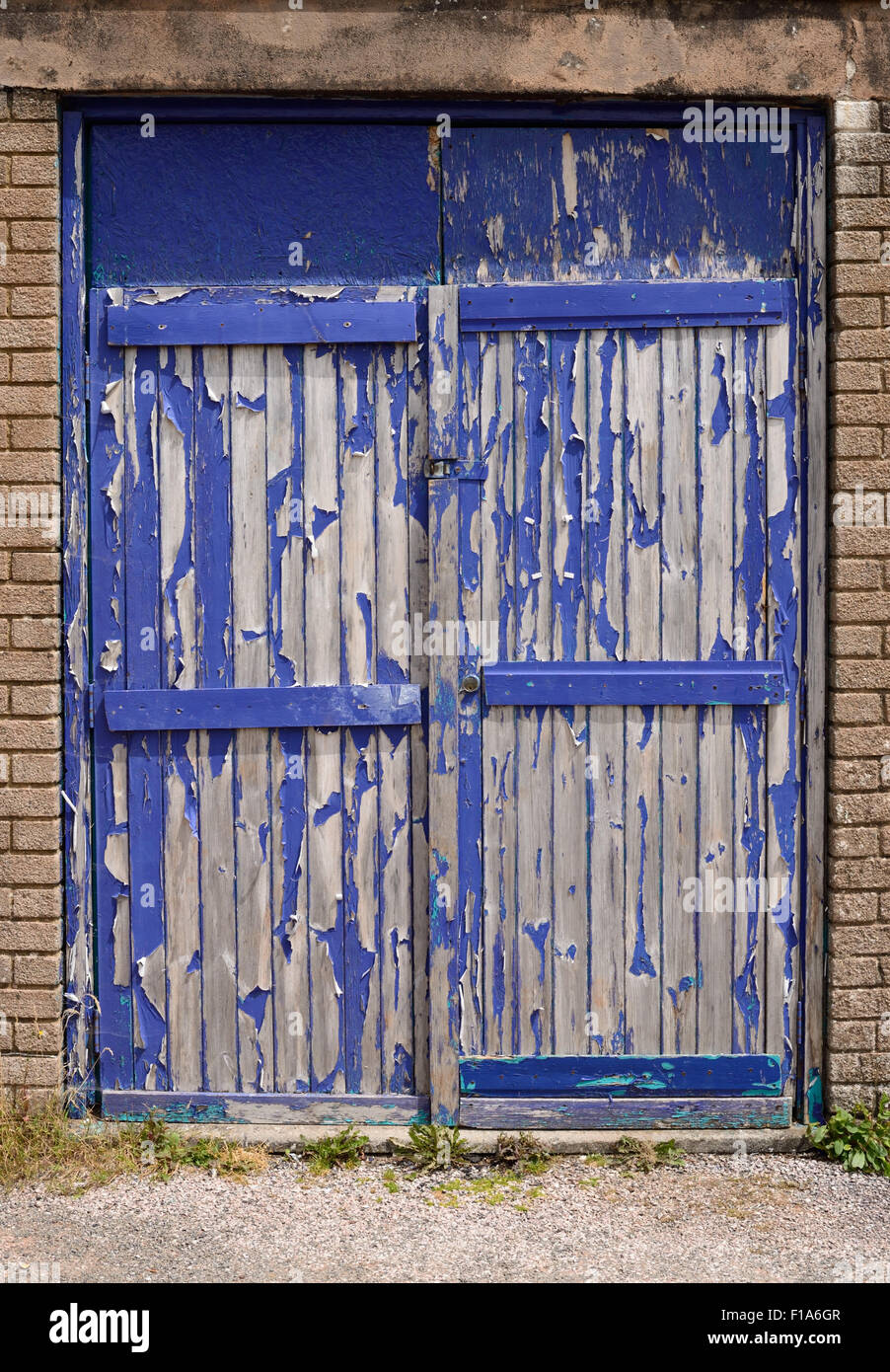Double doors in need of some repair. - Stock Image