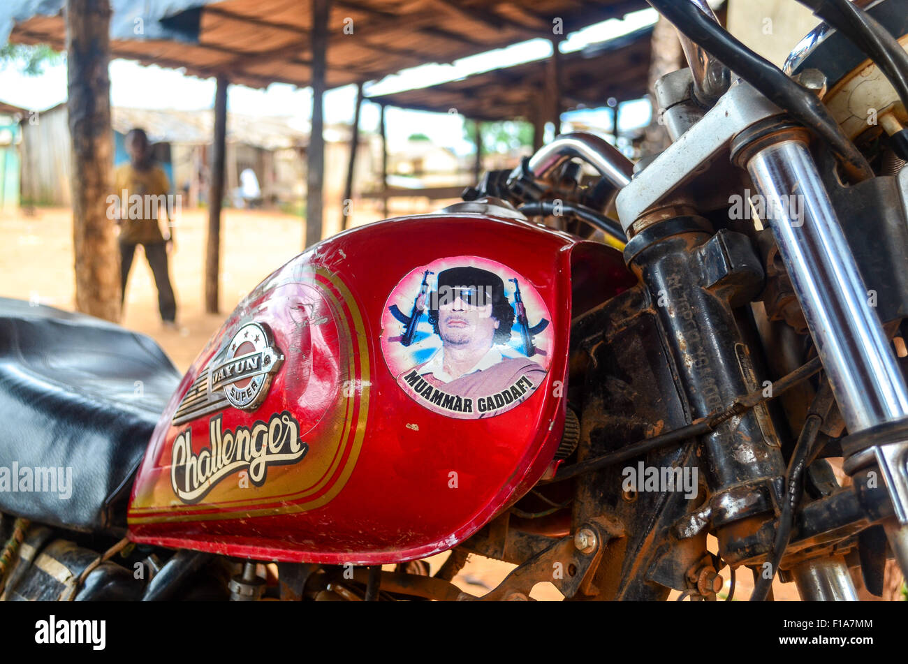 Sticker of Mouammar Gaddafi on a motorbike in Ivory Coast - Stock Image