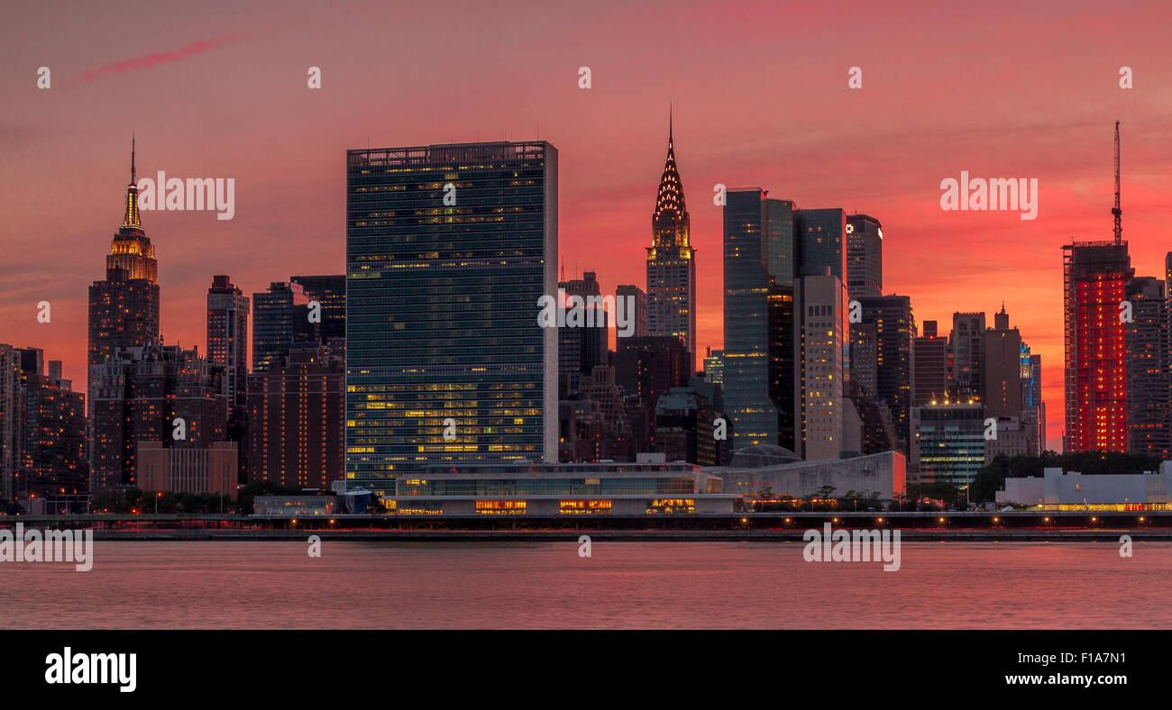 Manhattan skyline from across The East River at sunset  from Gantry State Park , Long Island City , NY - Stock Image