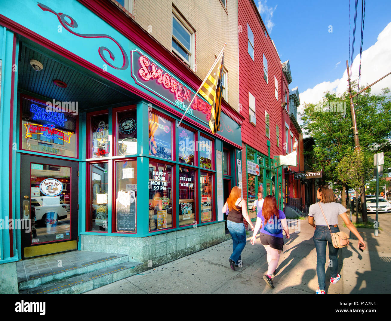 East Carson Street runs through Pittsburgh, Pennsylvania's South Side and is well known at a hot spot for weekend - Stock Image