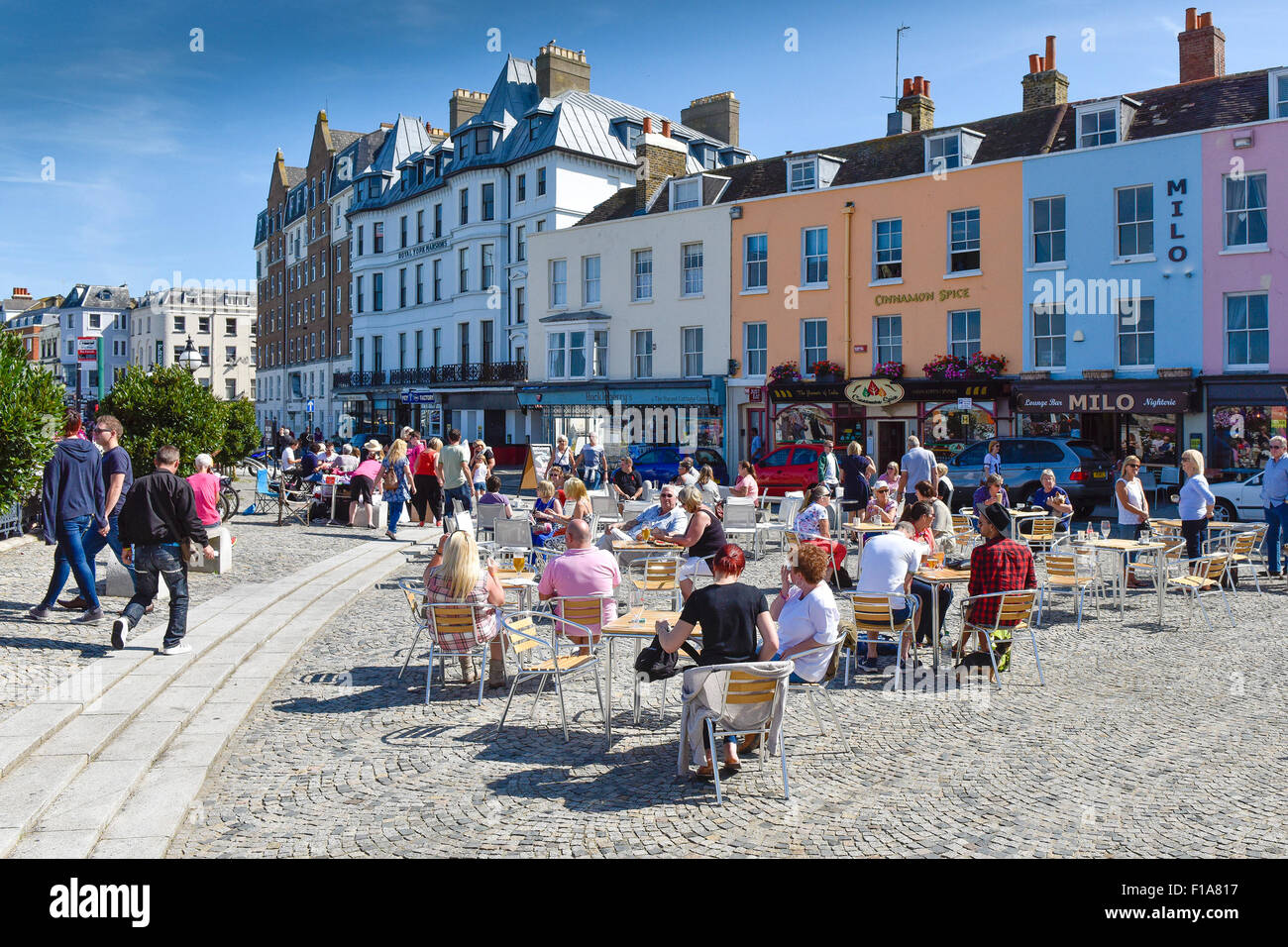 People enjoying the Summer sunshine as they relax in Margate, Kent. - Stock Image