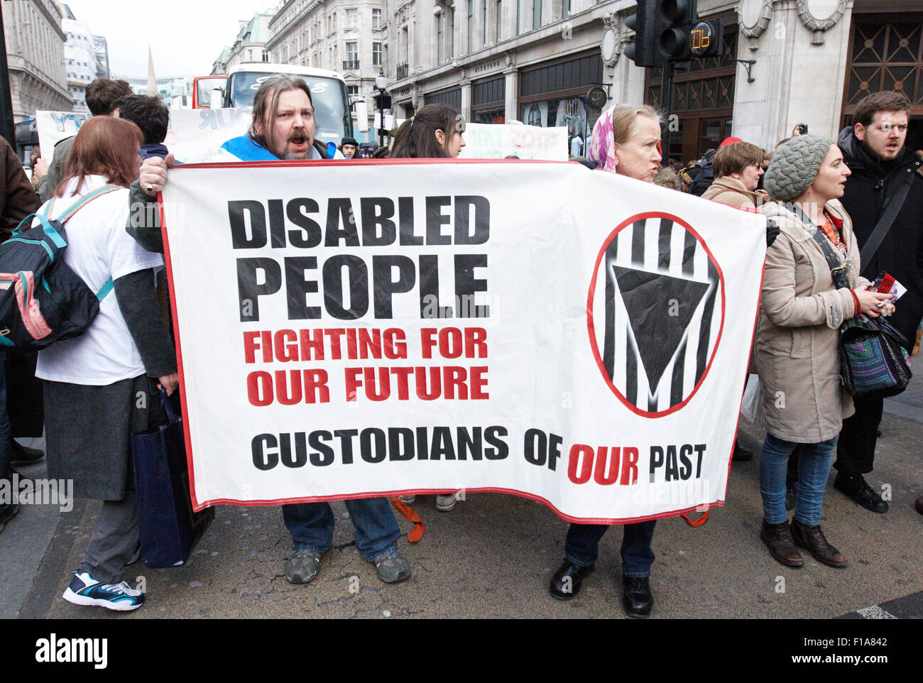 Members of Disabled People Against Cuts and UK Uncut demonstrate against government cuts and welfare reform - Stock Image
