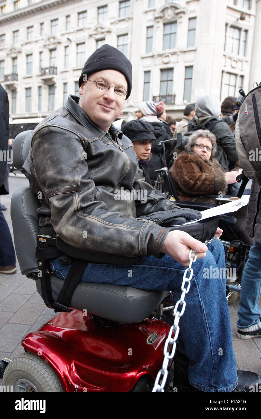 Members of Disabled People Against Cuts and UK Uncut demonstrate against government cuts and welfare reform Stock Photo
