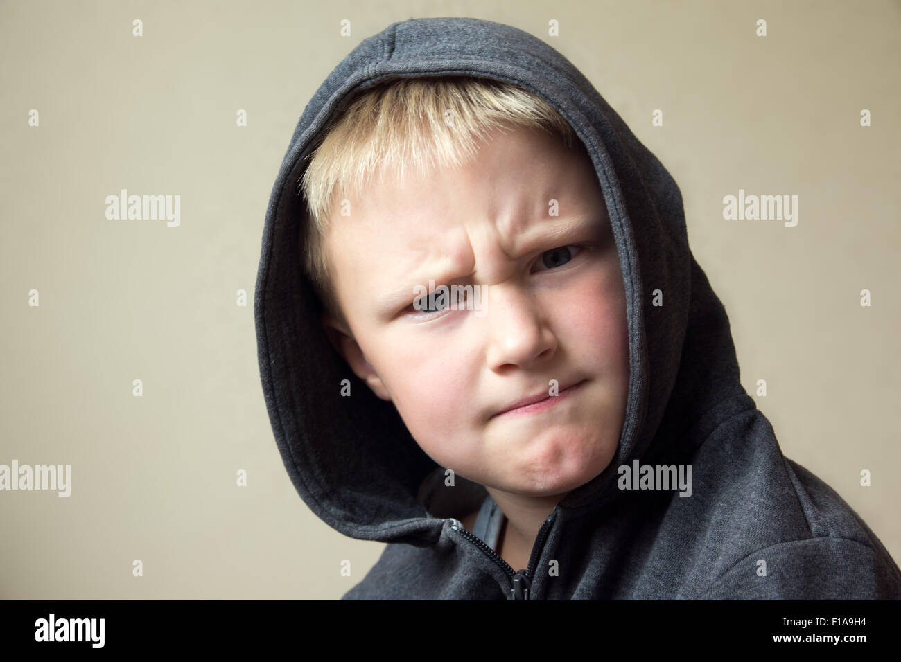 Angry child (boy, kid) portrait - Stock Image