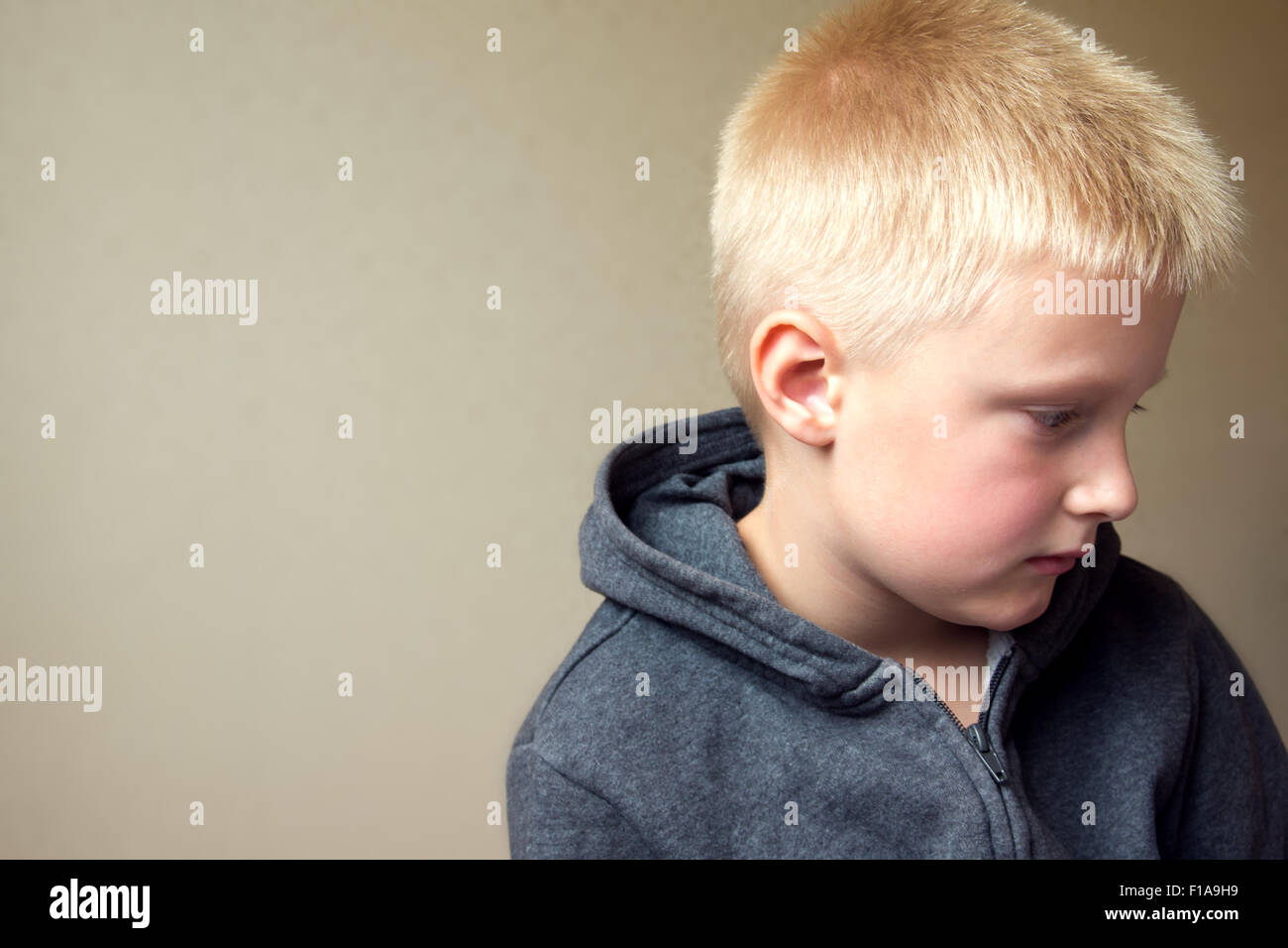 Angry upset sad child (boy, kid) portrait - Stock Image
