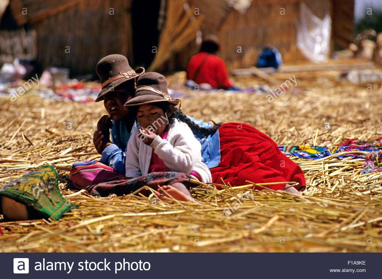 PERU / Puno / Lake Titicaca / Floating islands of the Uros / Uro girl with her mother - Stock Image