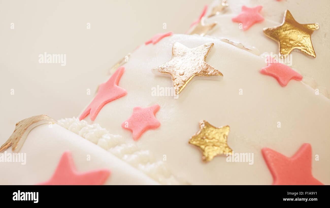 Birthday cake decorated with stars made of sugar. - Stock Image