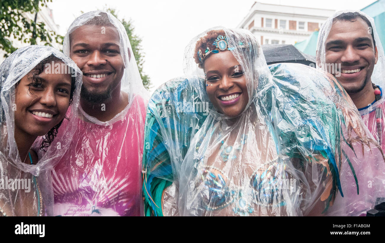 London, UK.  31 August 2015.  Dancers wearing rain ponchos at the start as heavy rain does not dampen the spirits - Stock Image