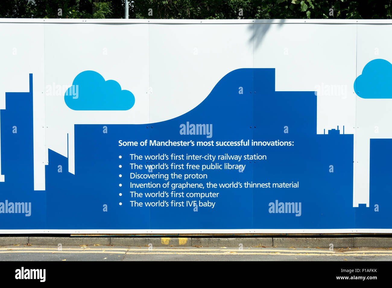 Hoarding listing some of Manchester's innovations, on a building site at Christie's Hospital, Manchester, - Stock Image
