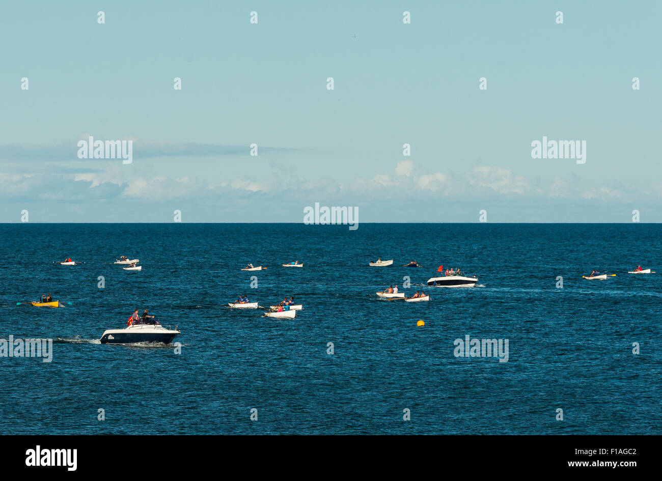 Teignmouth. 2015. A small boat race off the coast of Teignmouth during the summer regatta season. - Stock Image