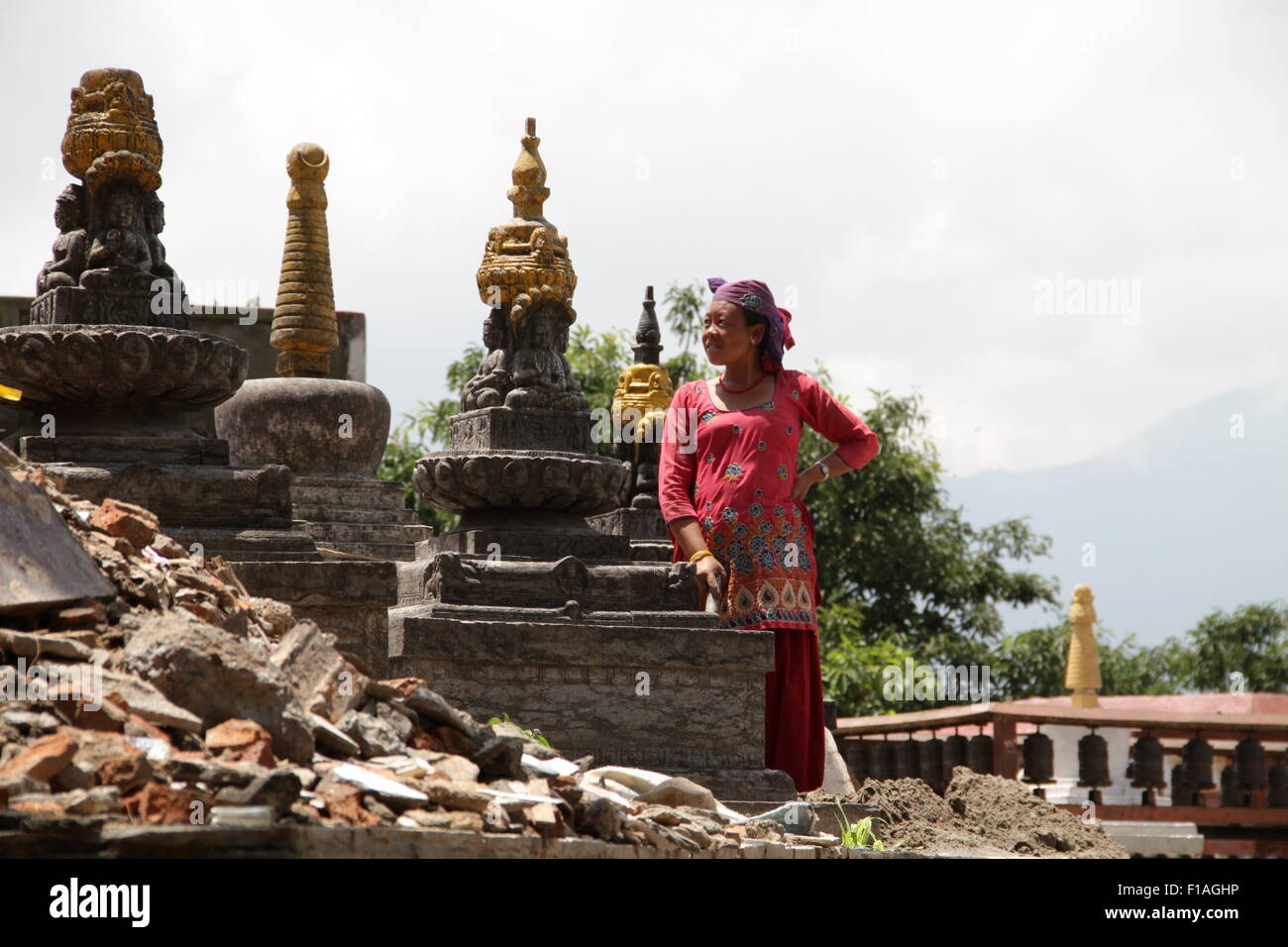 woman rebuilding a temple in Kathmandu, Nepal after the earthquake in 2015 Stock Photo