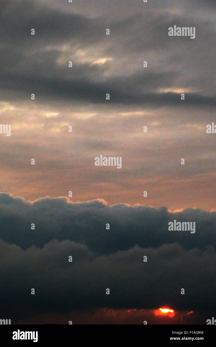 Berlin, Germany, cumulus cloud (front) and stratus clouds at dusk Stock Photo