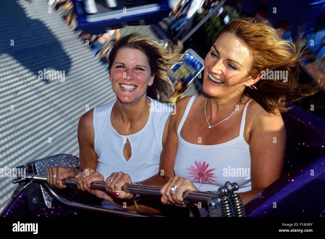 A couple of women enjoying a ride at Adventure Island. Southend-on-Sea. Essex. England - Stock Image